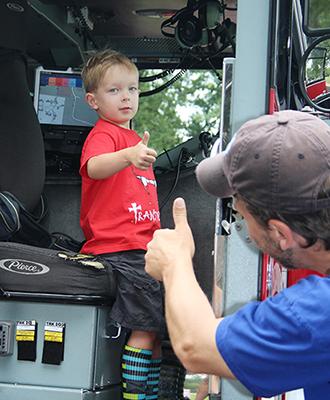 Alexandrians enjoy exploring City vehicles at Tons of Trucks.